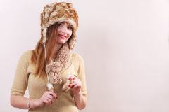Winter woman in warm clothing fur cap Stock Photography