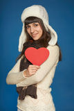 Winter woman in warm clothing giving heart shape Royalty Free Stock Image