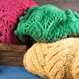 Winter womans woolen sweaters. Knitted clothing. Square Royalty Free Stock Images