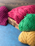 Winter womans woolen sweaters. Knitted clothing. Vertical Stock Photos