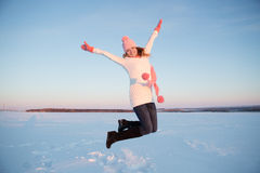 Winter women jump in snow Stock Images