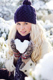 Winter women with the snow heart Royalty Free Stock Image