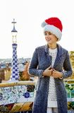 Smiling woman at Guell Park in Barcelona, Spain looking aside Stock Image