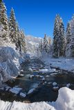 Winter wonderland - snowy river. Winter wonderland in the bavarian alps - snowy river in the forest stock photos