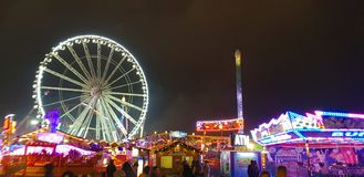 Winter Wonderland Christmas Fair at Hyde Park In London. Night time scene at the Winter Wonderland fairground held at Hyde Park in London England at Christmas stock image