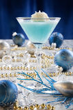 Winter Wonderland Cocktail. Closeup of Winter Wonderland Cocktail, garnished with coconut vanilla ice cream ball on Christmas decorated holiday table with Royalty Free Stock Image