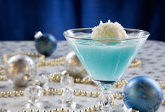 Winter Wonderland Cocktail. Closeup of Winter Wonderland Cocktail, garnished with coconut vanilla ice cream ball on Christmas decorated holiday table with Royalty Free Stock Photo
