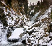 Winter wonderland landscape of frozen ice and river in deep winter in the Alps. A winter wonderland landscape of frozen ice and river in deep winter in the Alps royalty free stock photography