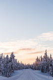 Winter wonderland lapland scene sunset road Stock Photos