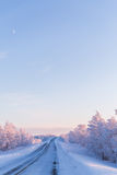 Winter wonderland lapland scene sunset road. Winter wonderland lapland scene snowy forest Royalty Free Stock Photo