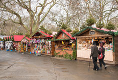 Winter wonderland London Christmas market. London, UK - December 10, 2015: Christmas market with small shops selling Christmas gifts and people around at Winter royalty free stock images