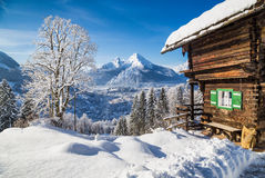 Winter wonderland with mountain chalet in the Alps Stock Image