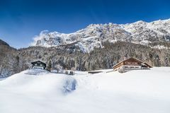 Winter wonderland with mountain chalets in the Alps stock photo