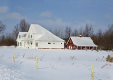 Winter Wonderland. A red barn and out-building in sits in a field of Winter white in Western New York Royalty Free Stock Photo