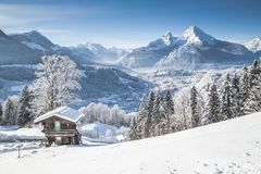 Winter wonderland scenery in the Alps with traditional mountain stock photography
