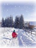 Winter wonderland snow. Girl on sledge Royalty Free Stock Photography