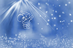 Winter wonderland. Teddy bear  with bag of presents on snowy blue background.  Stock Photography