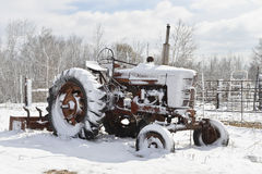 Winter Wonderland Tractor. Antique Farm Tractor in Snow Stock Images
