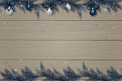 Winter wooden background with spruce branches, decorations and snow Stock Image