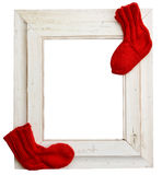 Winter wooden frame, red socks Royalty Free Stock Images