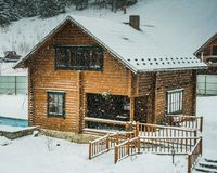 Winter wooden house in snow. Winter landscape winter wooden house in snow Christmas winter fairy tale goes snow Stock Image