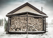 Winter - woodshed filled with birch firewood Stock Photo