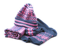 Winter woollen set isolated on white background. Winter woollen set of knitted cap, scarf, pair of socks and headband  isolated on white background Royalty Free Stock Photography