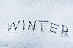 Winter word written in snow Stock Image