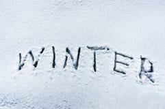Winter word written in snow Stock Image