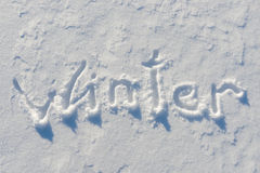 Winter word written on the snow Royalty Free Stock Image