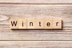 Winter word written on wood block. winter text on table, concept.  Royalty Free Stock Photo