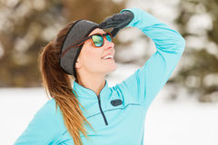 Winter workout. Girl wearing sportswear and sunglasses. Royalty Free Stock Images