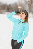 Winter workout. Girl wearing sportswear and sunglasses. Stock Image