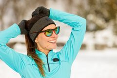 Winter workout. Girl wearing sportswear and sunglasses. Royalty Free Stock Image