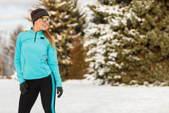 Winter workout. Girl wearing sportswear and sunglasses. Royalty Free Stock Photo