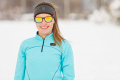 Winter workout. Girl wearing sportswear and sunglasses. Stock Photos