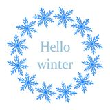 Winter wreath of blue snowflakes on white background. Cold weather winter symbols royalty free illustration