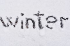 Winter written in snow background Stock Image