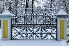 Winter wrought fence gates Royalty Free Stock Photo