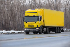 Winter yellow truck Royalty Free Stock Photo