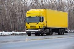 Winter yellow truck Royalty Free Stock Photo