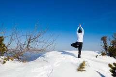 Winter yoga session in beautiful mountain place Royalty Free Stock Photos
