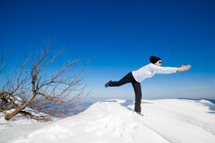 Winter yoga session in beautiful mountain place Royalty Free Stock Images