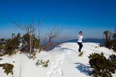 Winter yoga session in beautiful mountain place Stock Photos