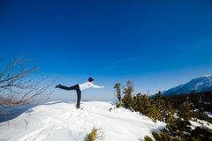 Winter yoga session in beautiful mountain place Stock Image