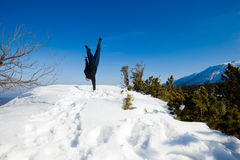 Winter yoga session in beautiful mountain place Stock Images