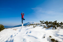 Winter yoga session in beautiful mountain place Royalty Free Stock Photo