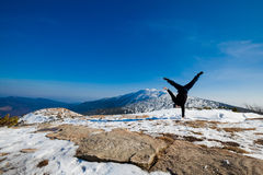 Winter yoga session in beautiful mountain place Stock Photo