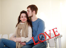 Winter young pensive couple in love Stock Photos