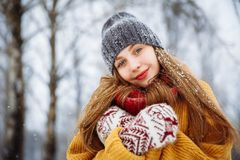 Winter young woman portrait. Beauty Joyful Model Girl laughing and having fun in winter park. Beautiful young female royalty free stock image